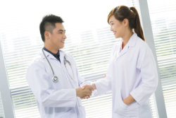 two medical staff doing handshake